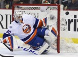 15 March 2016: New York Islanders goalie Jean-Francois Berube (30) makes a save during the third period. The Pittsburgh Penguins won 2-1 in a shootout against the New York Islanders at the Consol Energy Center in Pittsburgh, Pennsylvania. (Photo by Jeanine Leech/Icon Sportswire)