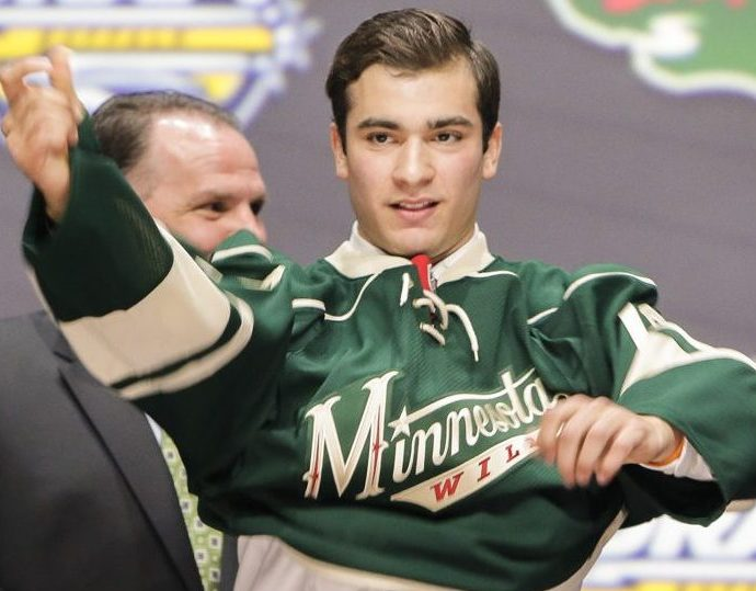 June 24, 2016: Luke Kunin dons his Wild sweater after he was selected by Minnesota as the 15th pick in the first round of the 2016 NHL Entry Draft at First Niagara Center in Buffalo, NY (Photo by John Crouch/Icon Sportswire.)