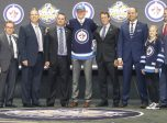 June 24, 2016: Patrik Laine poses for a group picture with Jets coaches and staff after being chosen second by the Winnipeg Jets during the 2016 NHL Entry Draft at First Niagara Center in Buffalo, NY (Photo by John Crouch/Icon Sportswire.)