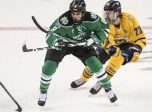 April 09, 2016: Nick Schmaltz (8) of North Dakota avoids the stick check and skates by Tommy Schutt (23) of Quinnipiac during the 2016 NCAA Frozen Four championship game between North Dakota and Quinnipiac at Amalie Arena in Tampa, FL. (Photograph by Roy K. Miller/Icon Sportswire)