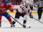 28 September 2014:  Michael Bournival #49 of the Montreal Canadiens challenges Nathan Walker #79 of the Washington Capitals during the NHL match at the Bell Centre in Montreal Quebec, Canada.  The Capitals defeated the Canadiens 2-0.