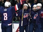 GRAND FORKS, NORTH DAKOTA - APRIL 24: USA's Adam Fox #8, Joey Anderson #17, Clayton Keller #19 and Kieffer Bellows #22 celebrate after a first period goal against Canada during bronze medal game action at the 2016 IIHF Ice Hockey U18 World Championship. (Photo by Minas Panagiotakis/HHOF-IIHF Images)