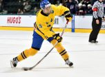 GRAND FORKS, NORTH DAKOTA - APRIL 16: Sweden's Timothy Liljegren #19 lets a shot go during preliminary round action against the U.S. at the 2016 IIHF Ice Hockey U18 World Championship. (Photo by Minas Panagiotakis/HHOF-IIHF Images)