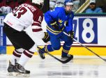 GRAND FORKS, NORTH DAKOTA - APRIL 15: Sweden's Elias Pettersson #21 skates with the puck while LatviaÕs Vlads Vulkanovs #13 defends during preliminary round action at the 2016 IIHF Ice Hockey U18 World Championship. (Photo by Matt Zambonin/HHOF-IIHF Images)