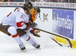 January 03 2015: Jonas Siegenthaler (25) of Switzerland fights for the puck against Germany during Switzerland's 5-2 victory over Germany at the IIHF World Junior Championship at Air Canada Centre in Toronto, Canada.