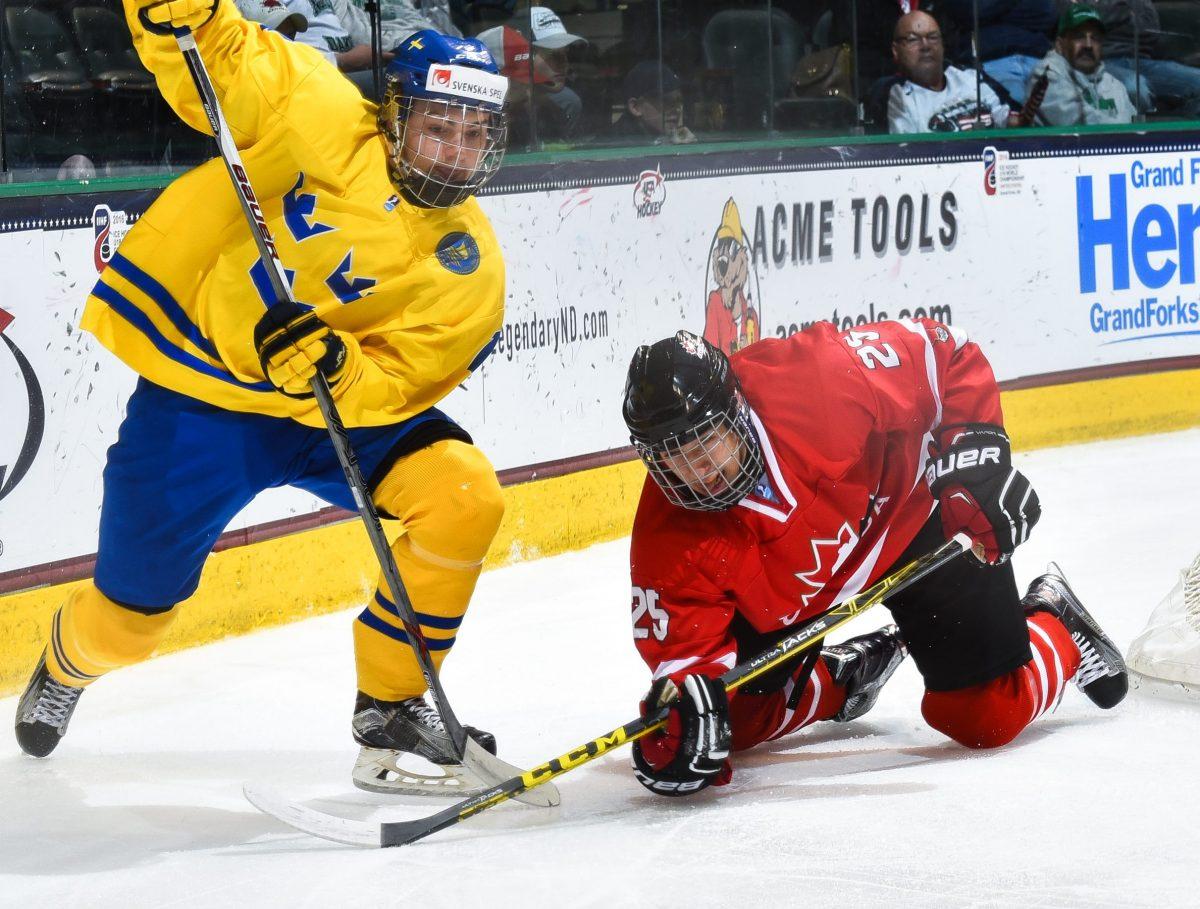 GRAND FORKS, NORTH DAKOTA - APRIL 23: Sweden's Erik Brannstrom #14 and Canada's Jordan Kyrou #25 battle for the puck during semifinal round action at the 2016 IIHF Ice Hockey U18 World Championship. (Photo by Matt Zambonin/HHOF-IIHF Images)