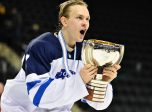 GRAND FORKS, NORTH DAKOTA - APRIL 24: Finland's Urho Vaakanainen #7 celebrating with the championship trophy after a 6-1 gold medal game win over Sweden at the 2016 IIHF Ice Hockey U18 World Championship. (Photo by Minas Panagiotakis/HHOF-IIHF Images)