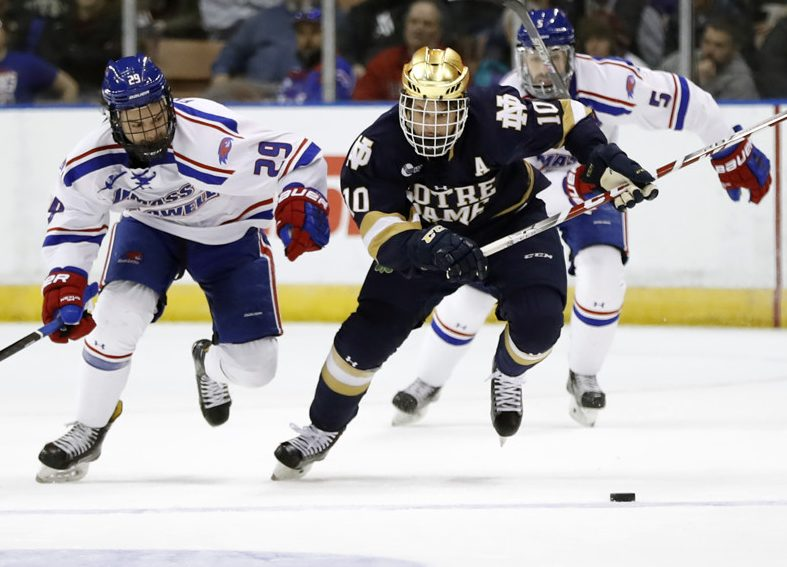 MANCHESTER, NH - MARCH 26: Notre Dame Fighting Irish right wing Anders Bjork (10) breaks away from UMass Lowell River Hawks right wing John Edwardh (29) during the NCAA Northeast Regional final between the UMass Lowell River Hawks and the Notre Dame Fighting Irish on March 26, 2017, at SNHU Arena in Manchester, New Hampshire. The Fighting Irish defeated the River Hawks 3-2 (OT). (Photo by Fred Kfoury III/Icon Sportswire)