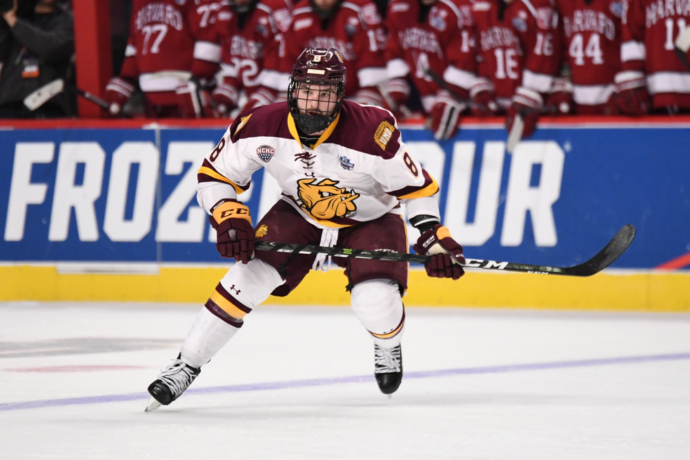 CHICAGO, IL - APRIL 06: Minnesota-Duluth Bulldogs wing Kyle Osterberg (8) in action in the third period of an NCAA Frozen Four semifinal game with the Harvard Crimson and the Minnesota-Duluth Bulldogs on April 6, 2017, at the United Center in Chicago, IL. Bulldogs won 2-1 to move on to the championship game. (Photo by Patrick Gorski/Icon Sportswire)