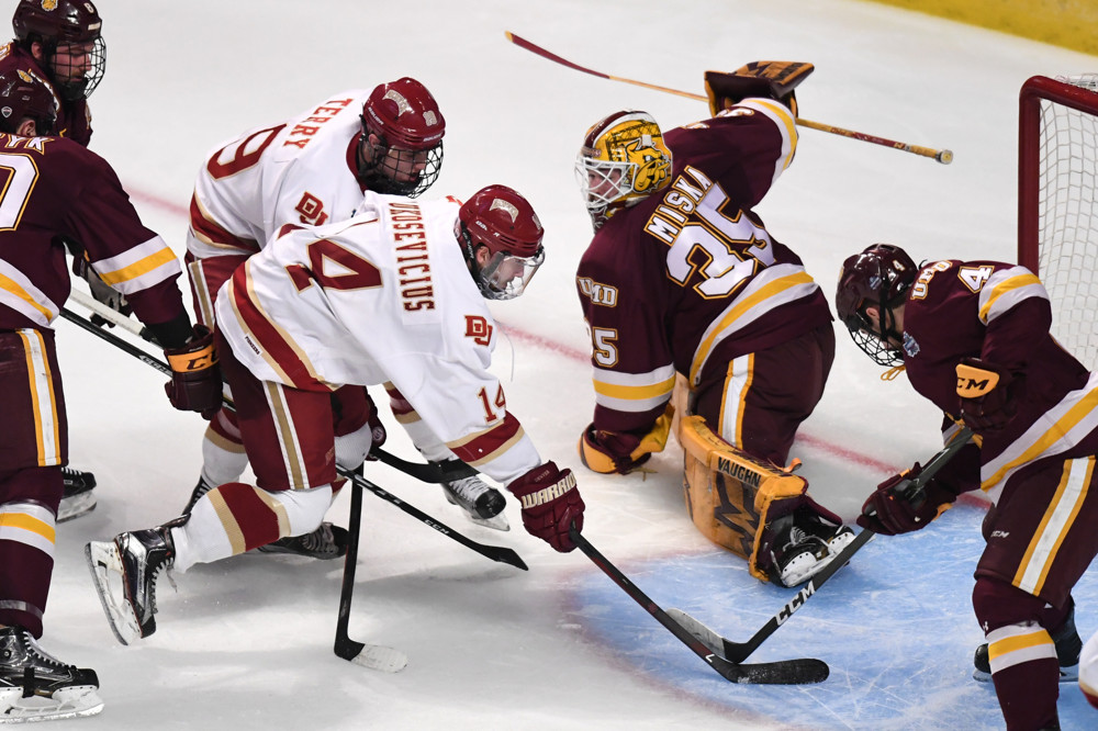 CHICAGO, IL - APRIL 08: Denver Pioneers forward Jarid Lukosevicius (14) scores a goal in the second period during the NCAA men's national championship game between the Minnesota-Duluth Bulldogs and the Denver Pioneers on April 8, 2017, at United Center in Chicago, IL. (Photo by Patrick Gorski/Icon Sportswire)
