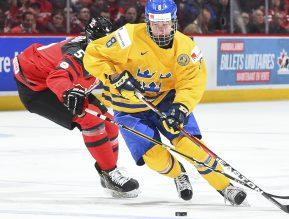 MONTREAL, CANADA - JANUARY 4: Canada's Thomas Chabot#5 stick checks Sweden's Rasmus Dahlin #8 during semifinal round action at the 2017 IIHF World Junior Championship. (Photo by Matt Zambonin/HHOF-IIHF Images)