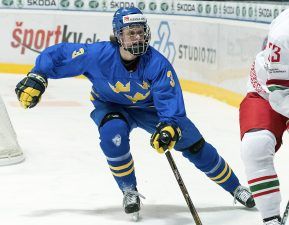 SPISSKA NOVA VES, SLOVAKIA - APRIL 16: Pavel Azhgirei #23 of Belarus plays the puck while Sweden's Adam Boqvist #3 defends during preliminary round action at the 2017 IIHF Ice Hockey U18 World Championship. (Photo by Steve Kingsman/HHOF-IIHF Images)