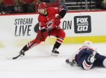 RALEIGH, NC - SEPTEMBER 29: Carolina Hurricanes center Martin Necas (88) and Washington Capitals defenseman Madison Bowey (22) during the 1st  period of the Carolina Hurricanes game versus the Washington Capitals on September 29, 2017, at PNC Arena (Photo by Jaylynn Nash/Icon Sportswire)