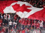 MONTREAL, CANADA - JANUARY 5: Canada's Carter Hart #31 looks on as the Canadian flag makes its way around Centre Bell during gold medal game action against the U.S. at the 2017 IIHF World Junior Championship. (Photo by Andre Ringuette/HHOF-IIHF Images)