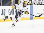 ANN ARBOR, MI - MARCH 03: Michigan Wolverines defenseman Quinn Hughes (43) passes the puck during the Michigan Wolverines game versus the Wisconsin Badgers in the BIG10 Hockey Tournament on March 3, 2018, at Red Berenson Rink at Yost Ice Arena in Ann Arbor, Michigan.  (Photo by Steven King/Icon Sportswire)