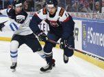 BUFFALO, NEW YORK - DECEMBER 30: Slovakia's Martin Fehervary #6 skates with the puck while Finland's Joni Ikonen #27 chases him down during preliminary round action at the 2018 IIHF World Junior Championship. (Photo by Matt Zambonin/HHOF-IIHF Images)