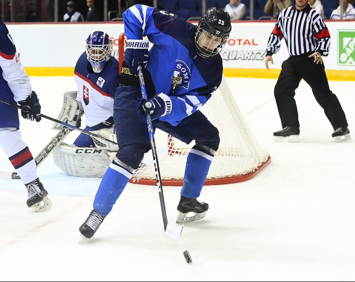 CHELYABINSK, RUSSIA - APRIL 19: Finland's Kaapo Kakko #33 plays the puck while while Slovakia's Nicolas Ferenyi #11 looks on during preliminary round action at the 2018 IIHF Ice Hockey U18 World Championship. (Photo by Andrea Cardin/HHOF-IIHF Images)