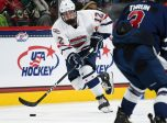 ST. PAUL, MN - SEPTEMBER 19: Team Langenbrunner forward John Farinacci (12) skates with the puck during the USA Hockey All-American Prospects Game between Team Leopold and Team Langenbrunner on September 19, 2018 at Xcel Energy Center in St. Paul, MN. Team Leopold defeated Team Langenbrunner 6-4.(Photo by Nick Wosika/Icon Sportswire)