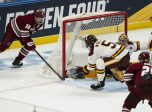 BUFFALO, NY - APRIL 13: Massachusetts Minutemen Defenseman Cale Makar (16) takes a shot on goal with Minnesota Duluth Bulldogs Defenseman Nick Wolff (5) defending and Minnesota Duluth Bulldogs Goaltender Hunter Shepard (32) defending during the first period of the NCAA Hockey Frozen Four championship game between the Massachusetts Minutemen and the Minnesota Duluth Bulldogs on April 13, 2019, at KeyBank Center in Buffalo, NY. (Photo by Gregory Fisher/Icon Sportswire)
