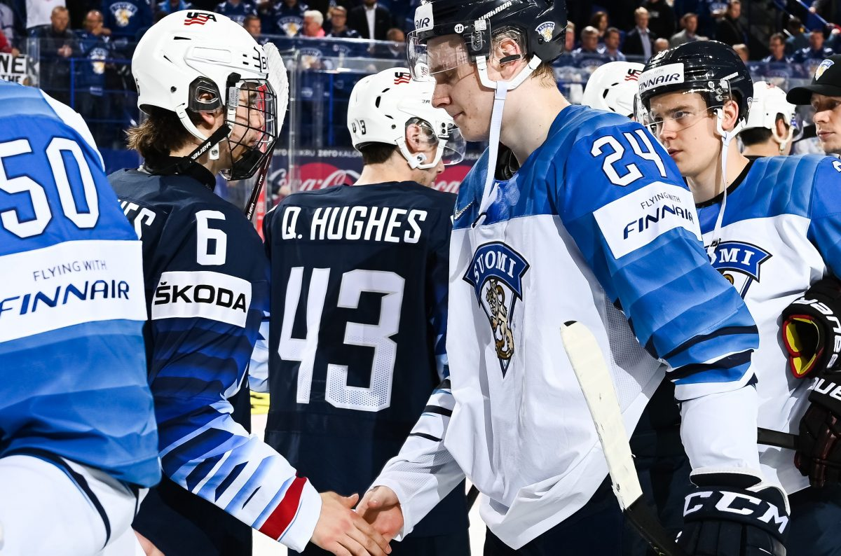 KOSICE, SLOVAKIA - MAY 13: USA's Jack Hughes #6 and Finland's Kaapo Kakko #24 shake hands following a 3-2 overtime win for team USA during preliminary round action of the 2019 IIHF Ice Hockey World Championship at Steel Arena on May 13, 2019 in Kosice, Slovakia. (Photo by Matt Zambonin/HHOF-IIHF Images)