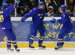 ORNSKOLDSVKIK, SWEDEN - APRIL 28: Sweden's Lucas Raymond #26 celebrates with Karl Henriksson #20 and Alexander Holtz #27 after scoring a third period goal on Team Russia during the gold medal game of the 2019 IIHF Ice Hockey U18 World Championship at Fjallraven Center on April 28, 2019 in Ornskoldsvkik, Sweden. (Photo by Chris Tanouye/HHOF-IIHF Images)