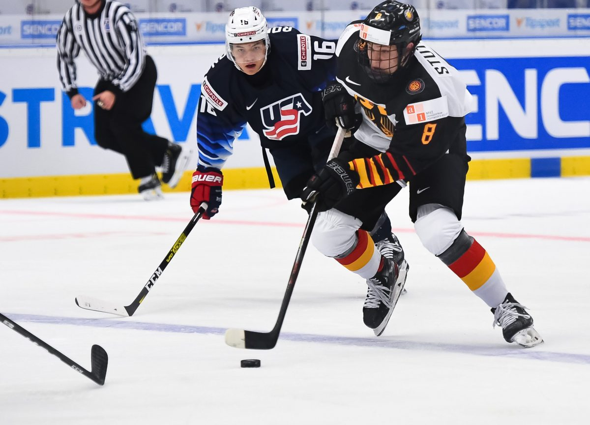 OSTRAVA, CZECH REPUBLIC - DECEMBER 27: Germany's Tim Stutzle #8 skates with the puck while USAÕs Nicholas Robertson #16 chases him down during preliminary round action at the 2020 IIHF World Junior Championship at Ostravar Arena on December 27, 2019 in Ostrava, Czech Republic. (Photo by Andrea Cardin/HHOF-IIHF Images)