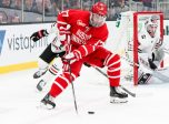 BOSTON, MA - FEBRUARY 10: Boston University Terriers forward Jake Wise (17) spins around to take a shot on goal during Beanpot Tournament Championship game between the Northeastern Huskies and Boston University Terriers on February 10, 2020, at TD Garden in Boston, Massachusetts.  (Photo by Mark Box/Icon Sportswire)
