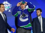 VANCOUVER, BC - JUNE 21:  Vasily Podkolzin puts on a hat after being selected tenth overall by the Vancouver Canucks during the first round of the 2019 NHL Draft at Rogers Arena on June 21, 2019 in Vancouver, British Columbia, Canada. (Photo by Derek Cain/Icon Sportswire)